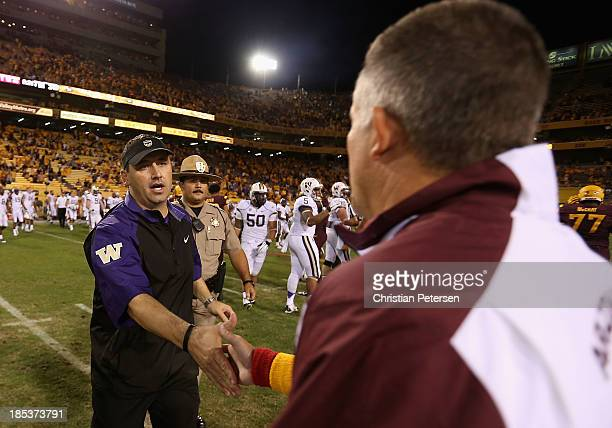 Head coach Steve Sarkisian of the Washington Huskies shakes hands with Todd Graham of the Arizona State Sun Devils following the college football...