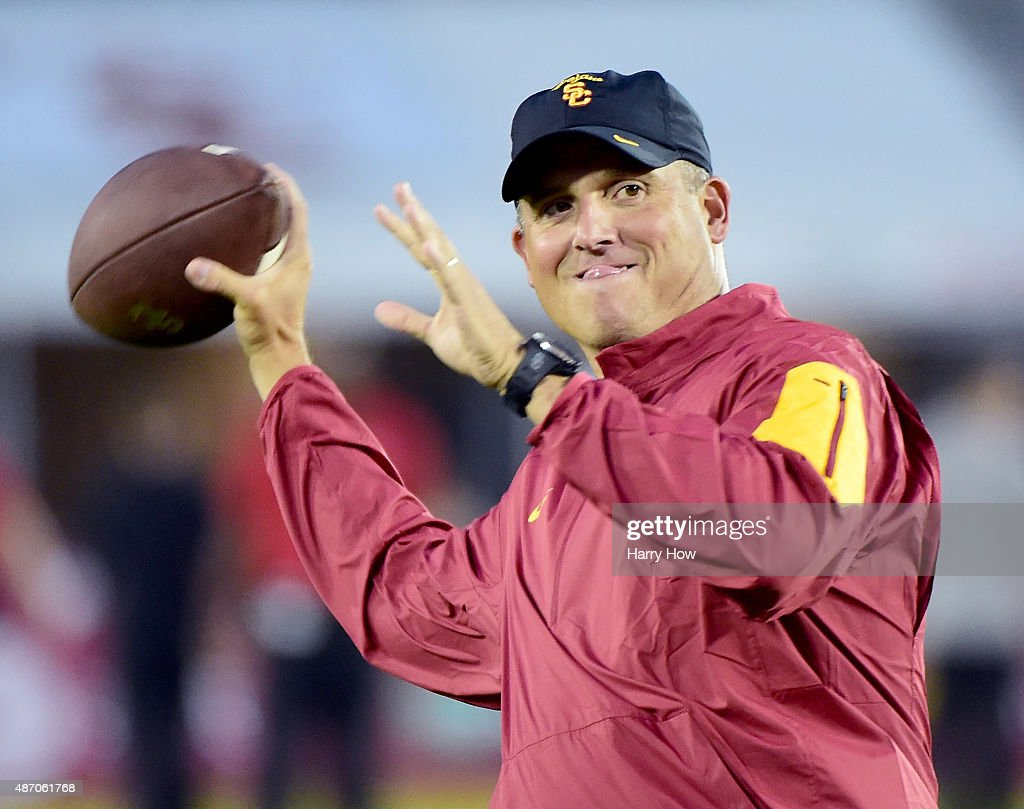 Head coach Steve Sarkisian throws as his team warms up before the game against Arkansas State at Los Angeles Coliseum on September 5, 2015 in Los Angeles, California.