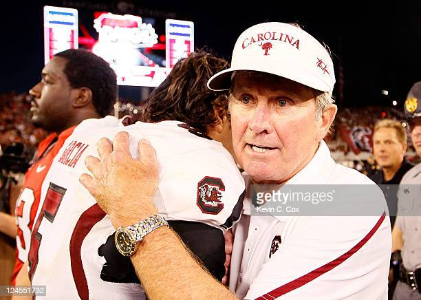 Head coach Steve Spurrier of the South Carolina Gamecocks and Stephen Garcia celebrate after their 4542 win over the Georgia Bulldogs at Sanford...