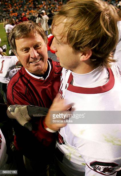 Head coach Steve Spurrier of the South Carolina Gamecocks celebrates a 1615 victory over the Tennessee Volunteers with his quarterback Blake Mitchell...