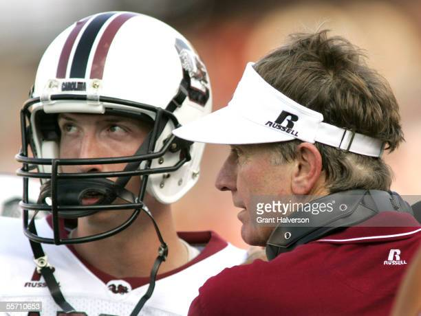 Head coach Steve Spurrier of the South Carolina Gamecocks confers with his quarterback Blake Mitchell during their game against the Alabama Crimson...