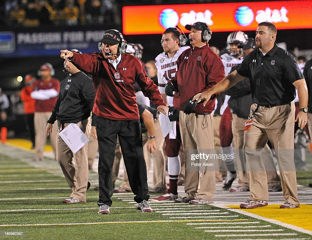 Head coach Steve Spurrier of the South Carolina Gamecocks points out instructions against the Missouri Tigers during the second half on October 26, 2013 at Faurot Field/Memorial Stadium in Columbia, Missouri. South Carolina won in double overtime 27-24.