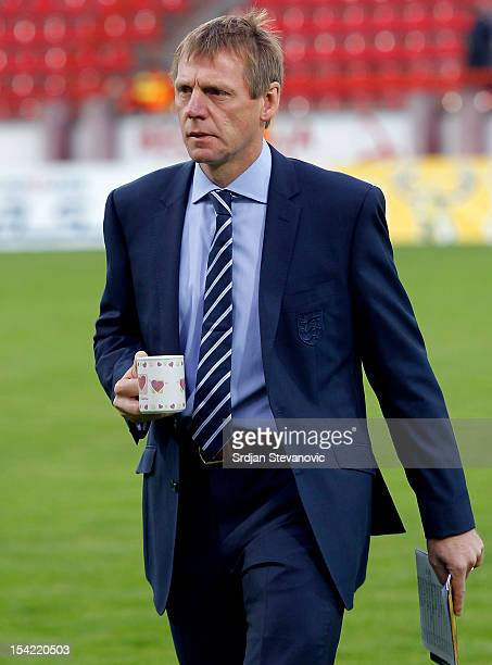 Head coach Stuart Pearce walks across the pitch holding a mug prior to the Under 21 European Championship Play Off second leg match between Serbia...