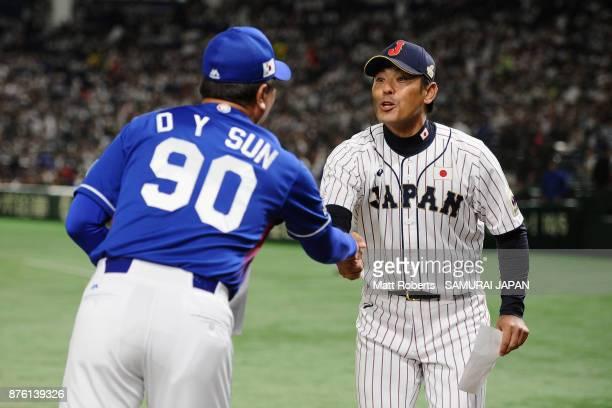 Head coach Sun Dongyol of South Korea and Head coach Atsunori Inaba of Japan shake hands prior to the Eneos Asia Professional Baseball Championship...