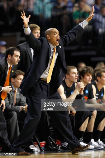 Head coach Sydney Johnson of the Princeton Tigers reacts as he coaches against the Kentucky Wildcats during the second round of the 2011 NCAA men's...