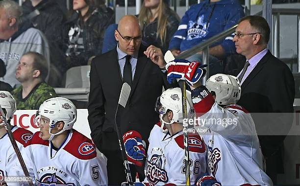 Head coach Sylvain Lefebvre of the St John's IceCaps has a chat with Brett Lemout during AHL game action against the Toronto Marlies on December 26...