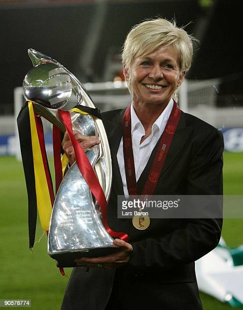 Head coach Sylvia Neid of Germany presents the trophy after winning the UEFA Women's Euro 2009 Final match between England and Germany at the...