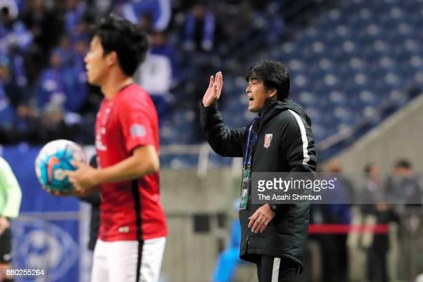 Head coach Takafumi Mori of Urawa Red Diamonds gives instruction during the AFC Champions League Final second leg match between Urawa Red Diamonds...
