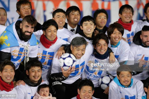 Head coach Takuya Takagi and VVaren Nagasaki players celebrate after his side's 31 victory and the promotion to the J1 after the JLeague J2 match...