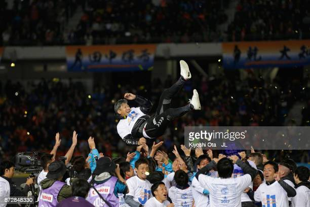 Head coach Takuya Takagi of VVaren Nagasaki is tossed into the air after his side's 31 victory and the promotion to the J1 after the JLeague J2 match...