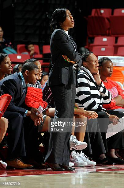 Head coach Tamika Louis of the Delaware State Hornets watches the game against the Maryland Terrapins at the Comcast Center on December 14 2013 in...