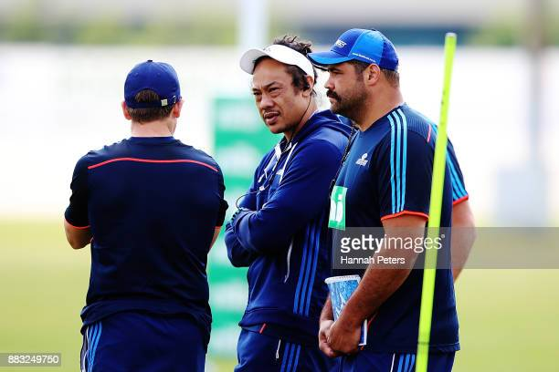 Head coach Tana Umaga talks with scrum coach Ben Afeaki during an Auckland Blues Super Rugby pre season training session ahead of the 2018 Investec...