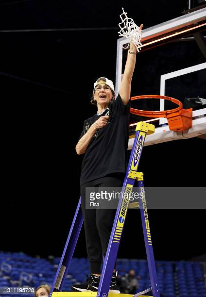 Head coach Tara VanDerveer of the Stanford Cardinal celebrates after cutting down the net during the National Championship game of the 2021 NCAA...