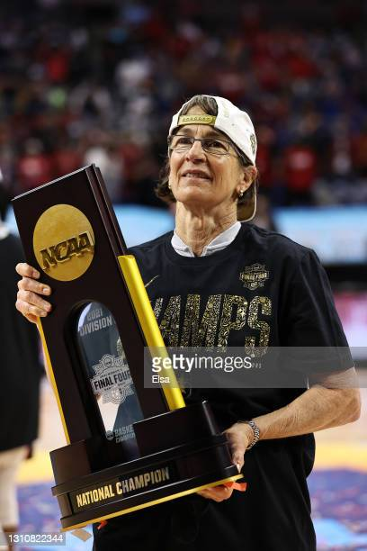 Head coach Tara VanDerveer of the Stanford Cardinal celebrates with the trophy after the team's win against the Arizona Wildcats in the National...