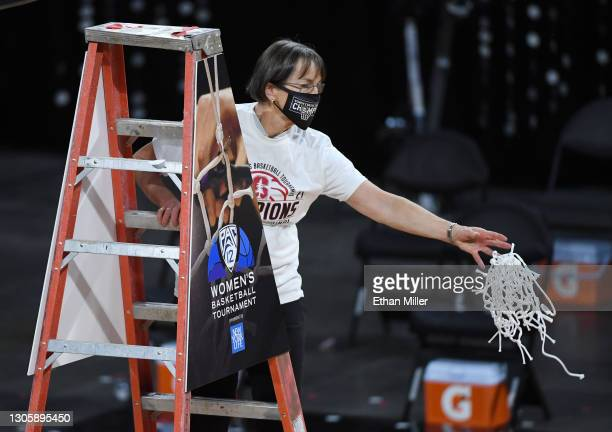 Head coach Tara VanDerveer of the Stanford Cardinal cuts down a net after her team's 75-55 victory over the UCLA Bruins to win the championship game...