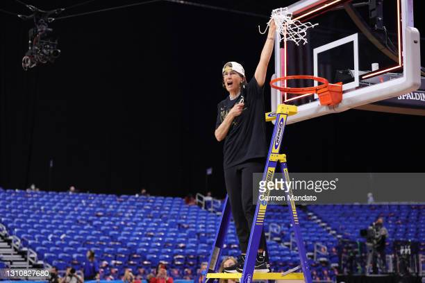Head coach Tara VanDerveer of the Stanford Cardinal cuts down the net after the team's win against the Arizona Wildcats in the National Championship...