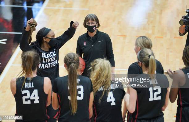 Head coach Tara VanDerveer of the Stanford Cardinal is congratulated by her team after she sets the record for the most victories in Division I...