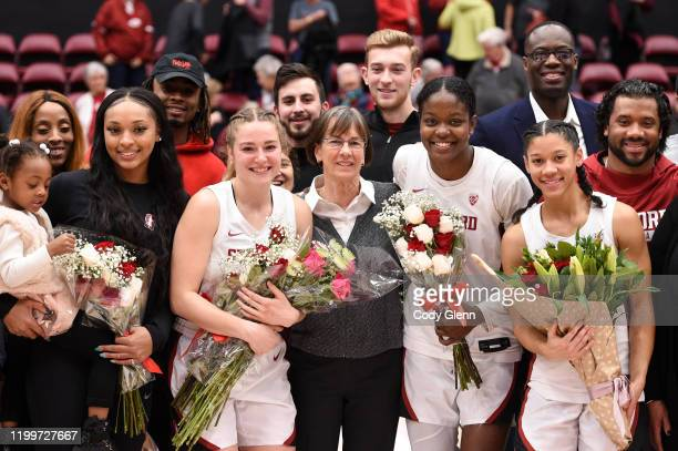 Head coach Tara VanDerveer of the Stanford Cardinal poses for a picture with her seniors including, from left, DiJonai Carrington, Mikaela Brewer,...