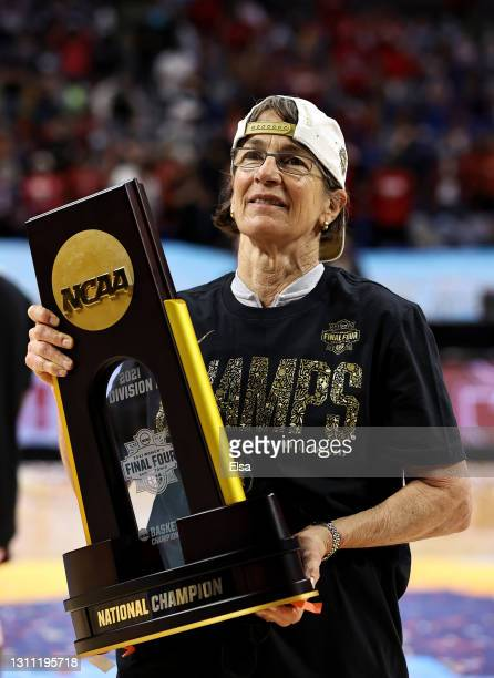 Head coach Tara VanDerveer of the Stanford Cardinal poses with the championship trophy after the National Championship game of the 2021 NCAA Women's...