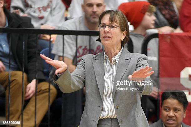 Head coach Tara VanDerveer of the Stanford Cardinal signals to her players during a college basketball game against the George Washington Colonials...