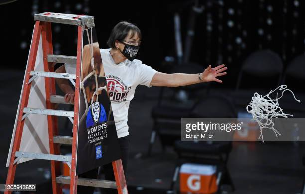 Head coach Tara VanDerveer of the Stanford Cardinal tosses a net after cutting it down after her team's 75-55 victory over the UCLA Bruins to win the...