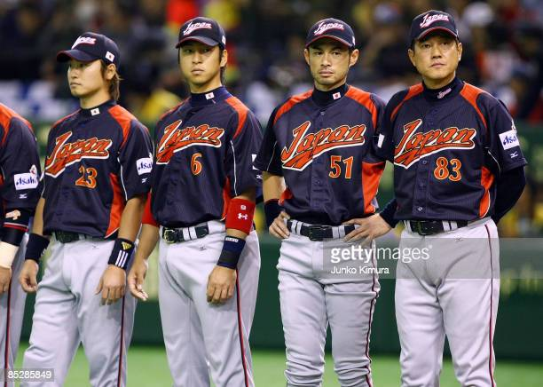 Head Coach Tatsunori Hara of Japan and players line up for the national anthem during the World Baseball Tokyo Round match between Japan and South...