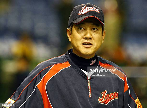 Head Coach Tatsunori Hara of Japan looks on during the practice session before the World Baseball Classic Pool A Tokyo Round match between South...