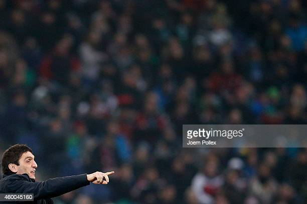 Head coach Tayfun Korkut of Hannover gestures during the Bundesliga match between Hannover 96 and VfL Wolfsburg at at HDIArena on December 6 2014 in...
