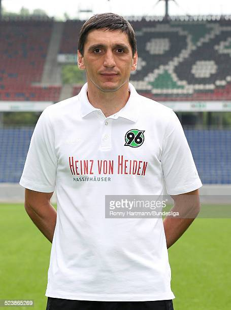Head coach Tayfun Korkut of Hanover poses during the Hannover 96 Media Day for DFL at the HDIArena on July 08 2014 in Hannover Germany