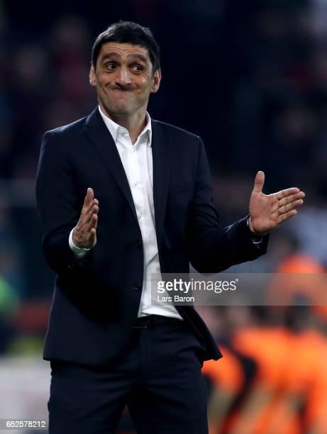 Head coach Tayfun Korkut of Leverkusen gestures during the Bundesliga match between Bayer 04 Leverkusen and Werder Bremen at BayArena on March 10...