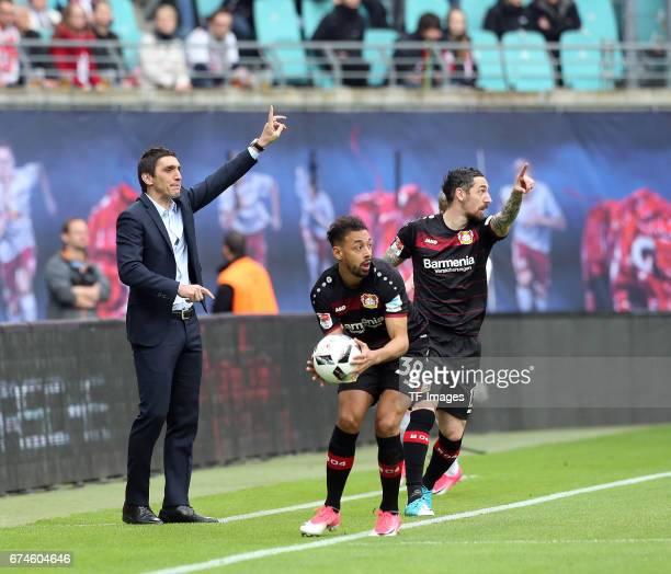 Head coach Tayfun Korkut of Leverkusen gestures during the Bundesliga match between RB Leipzig and Bayer 04 Leverkusen at Red Bull Arena on April 8...