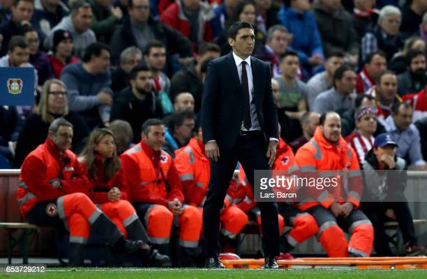 Head coach Tayfun Korkut of Leverkusen is seen during the UEFA Champions League Round of 16 second leg match between Club Atletico de Madrid and...