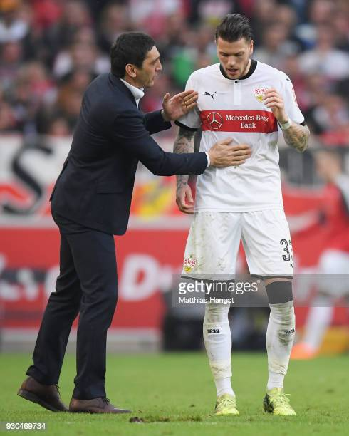 Head coach Tayfun Korkut of Stuttgart talks to Daniel Ginczek during the Bundesliga match between VfB Stuttgart and RB Leipzig at MercedesBenz Arena...