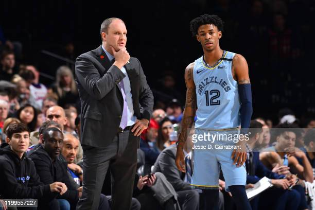 Head Coach Taylor Jenkins and Ja Morant of the Memphis Grizzlies talk during a game against the Philadelphia 76ers on February 7 2020 at the Wells...