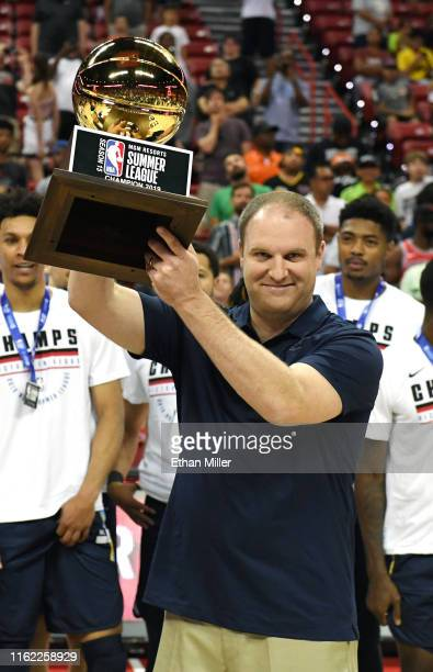 Head coach Taylor Jenkins of the Memphis Grizzlies holds up the championship trophy after his team's 9592 victory over the Minnesota Timberwolves to...