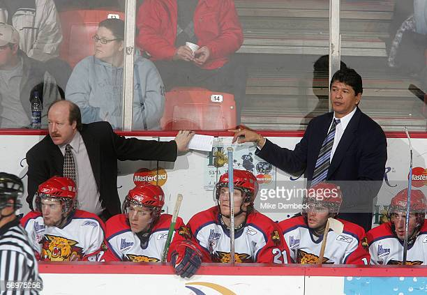 Head coach Ted Nolan of the Moncton Wildcats and Associate coach Danny Flynn look on from behind the bench during the game against the Halifax...