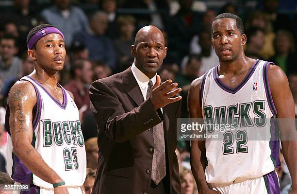 Head coach Terry Porter of the Milwaukee Bucks gives instructions to Maurice Williams and Michael Redd during a game against the Memphis Grizzlies on...