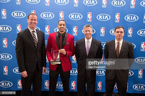 Head Coach Terry Stotts General Manager Neil Olshey and Team President Chris McGowan joins CJ McCollum of the Portland Trail Blazers as he receives...