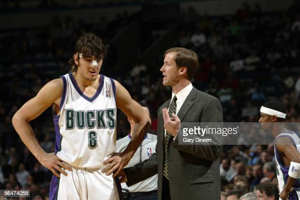 Head coach Terry Stotts of the Milwaukee Bucks talks with Andrew Bogut during the game against the Dallas Mavericks on November 29 2005 at the...
