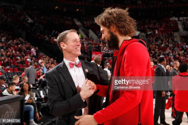 Head Coach Terry Stotts of the Portland Trail Blazers and Robin Lopez of the Chicago Bulls talk before the game on January 31 2018 at the Moda Center...
