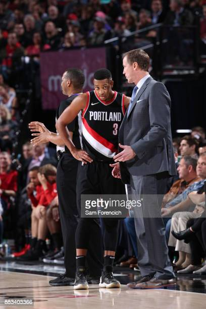 Head Coach Terry Stotts of the Portland Trail Blazers speaks with CJ McCollum of the Portland Trail Blazers during the game against the Los Angeles...
