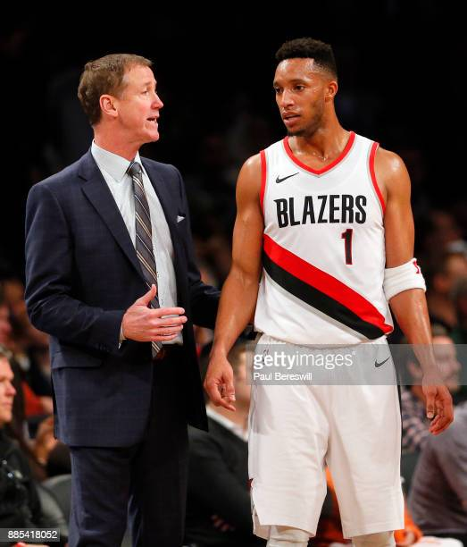 Head Coach Terry Stotts of the Portland Trail Blazers talks with Evan Turner of the Trail Blazers during a break in action in an NBA basketball game...