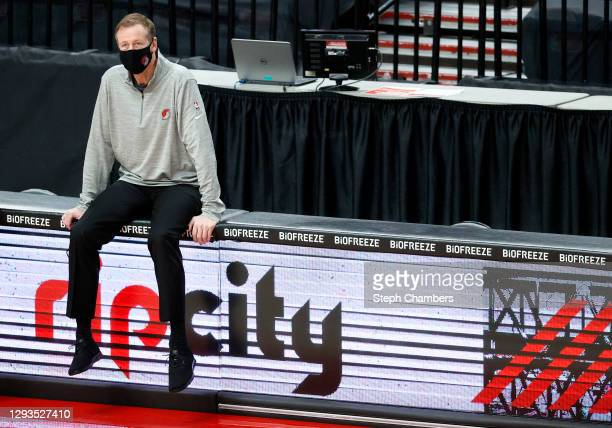 Head coach Terry Stotts of the Portland Trail Blazers watches warm ups before the game against the Houston Rockets at Moda Center on December 26,...