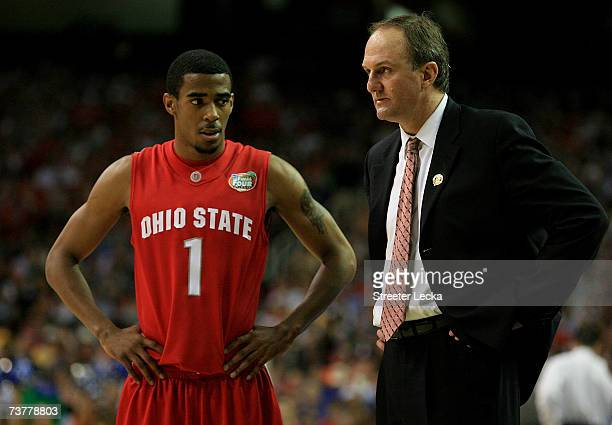 Head coach Thad Matta of the Ohio State Buckeyes talks with Mike Conley Jr during the NCAA Men's Basketball Championship game against the Florida...