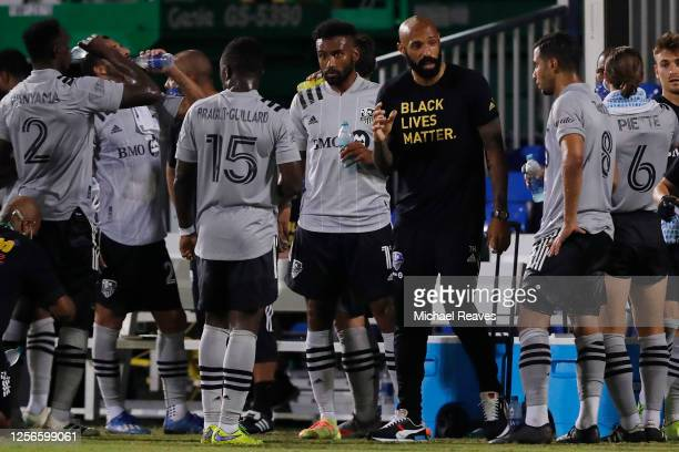 Head coach Thierry Henry of Montreal Impact talks with his team against Toronto FC during a Group C match as part of the MLS Is Back Tournament at...