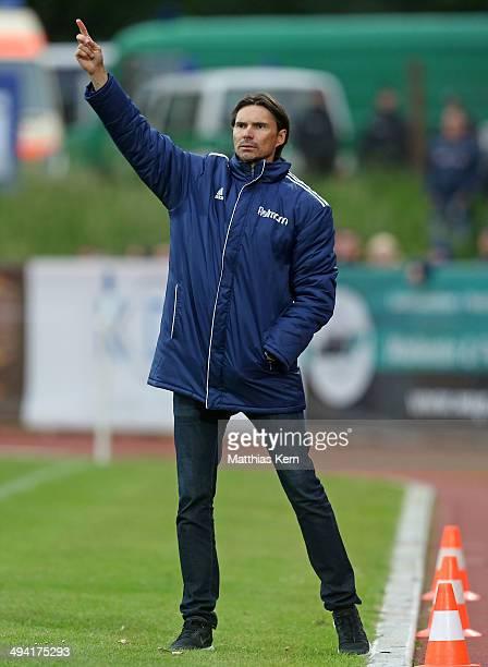 Head coach Thomas Brdaric of Neustrelitz gestures during the 3 Liga playoff leg 1 match between TSG Neustrelitz and 1FSV Mainz 05 II on May 28 2014...
