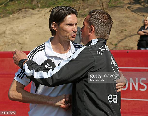 Head coach Thomas Brdaric of Neustrelitz talks with head coach Andreas Petersen of Magdeburg prior to the Regionalliga Nordost match between TSG...