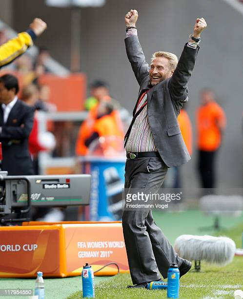 Head coach Thomas Dennerby of Sweden celebrates after winning the FIFA Women's World Cup 2011 Group C match between North Korea and Sweden at FIFA...