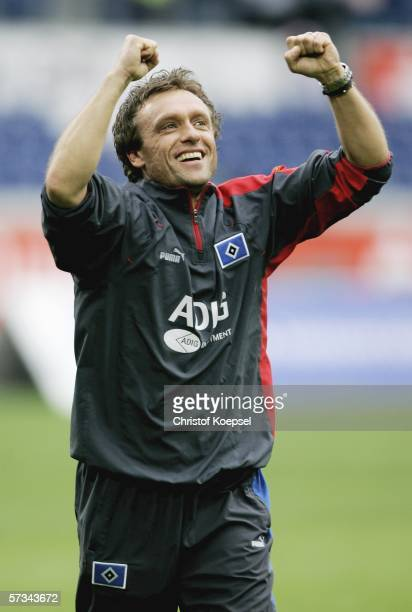 Head coach Thomas Doll of Hamburg celebrates the 20 victory of the Bundesliga match between MSV Duisburg and Hamburger SV at the MSV Arena on April...