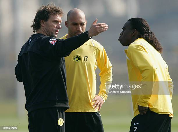 Head coach Thomas Doll talks to Dede and Tinga during the Borussia Dortmund training session at the training ground on March 13 2007 in Dortmund...